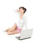 Young woman sitting on the floor with laptop Royalty Free Stock Photography