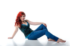 Young woman sitting on the floor Royalty Free Stock Photos