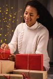 Young woman surrounded by presents Royalty Free Stock Image