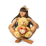 Young woman sitting on floor with teddy bear Stock Photography