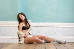 Young woman sitting on floor with underwear and sw Stock Photography