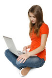 Woman sitting on the floor with her laptop Royalty Free Stock Photography