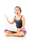 Young woman sitting on floor using laptop with looking frustrate Royalty Free Stock Images