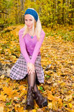 Young woman sitting in the forest Royalty Free Stock Photography