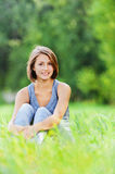 Young woman sitting grass Royalty Free Stock Image