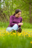 Young woman sitting on grass Royalty Free Stock Photos
