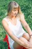 Young woman sitting on the grass Royalty Free Stock Photography