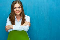 Young woman sitting on green chair. Stock Image