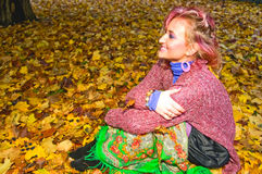 Young woman sitting on the ground Stock Image