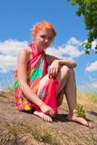 Young woman sitting on the ground Stock Photography