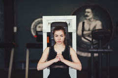 Young woman sitting at gym Stock Photo