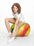 Young woman sitting on a gymnastic ball Royalty Free Stock Photos