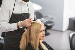 Young woman is sitting at hairdressers royalty free stock photography