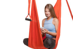 Young woman sitting in hammock for anti-gravity Royalty Free Stock Images