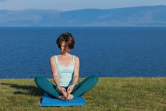 Woman meditating at seaside. royalty free stock photos