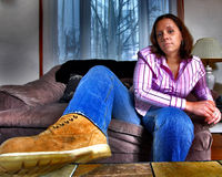Young Woman sitting, HDR. A young woman sitting with a boot on a table in HDR stock photos