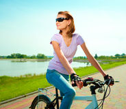 Young woman is sitting on her bicycle Stock Photo