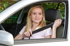 Young woman sitting in her car Stock Photography