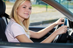 Young woman sitting in her car Stock Photo