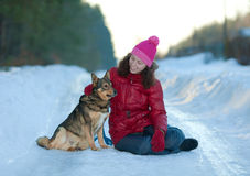 Young woman sitting with her dog Royalty Free Stock Photos