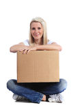 Young woman sitting and holding a moving box Royalty Free Stock Image