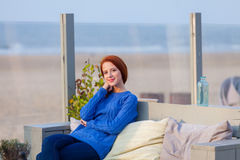 Young Woman Sitting In The Cafe On The Beach Stock Images