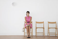 Free Young Woman Sitting In Waiting Room Stock Photo - 33810210