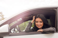 Young Woman Sitting Inside Car Smiling at Camera Royalty Free Stock Image