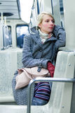 Young Woman Sitting inside a Metro Wagon Royalty Free Stock Images