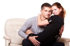 Young woman sitting on lap man Royalty Free Stock Photos