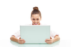 Young woman sitting with a laptop. Young woman over white background Royalty Free Stock Images