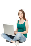 Young woman sitting with laptop. Portrait of a woman over white background Royalty Free Stock Images
