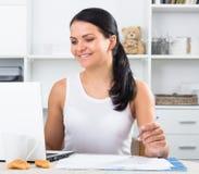 Young  woman sitting at  laptop Stock Photos