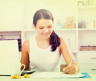 Young  woman sitting at  laptop Royalty Free Stock Photography