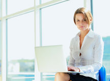 Young woman sitting with laptop computer. Young smiling woman sitting with laptop computer Stock Photos