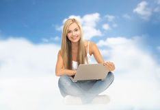 Young woman sitting with laptop Royalty Free Stock Photos