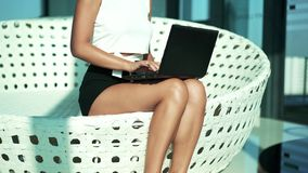 Young woman sitting with laptop, lounge room stock video footage