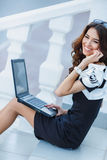 Young woman sitting with a laptop on a summer day Royalty Free Stock Photography