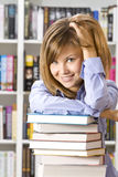 Young woman sitting  in  library Stock Image