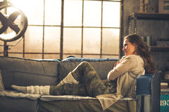 Young woman sitting in loft apartment Royalty Free Stock Photos