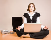 Young woman sitting in lotus pose Stock Photos