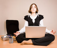 Young woman sitting in lotus pose Royalty Free Stock Photos
