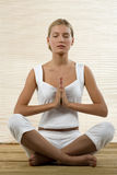 Young woman sitting in lotus position Stock Photo