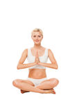 Young woman sitting in lotus position Stock Photos