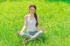 Young woman sitting in a lotus position. Stock Photography