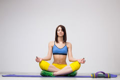 Young woman sitting in lotus position Royalty Free Stock Image