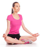 Young woman sitting in lotus position Stock Image