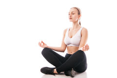 Young woman sitting in lotus position isolated Stock Image