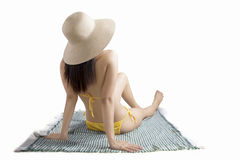 Young woman sitting on mat with bikini Royalty Free Stock Photo