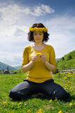 Young woman sitting in a meadow Royalty Free Stock Photography